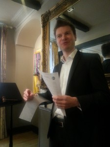 Introducing each speaker, Toastmaster James.